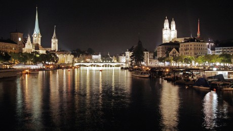 A night view taken 14 August 2007 the old town of Zurich with the Grossmuenster church (R) right and left of the Limmat river. Zurich is the largest city in Switzerland and the country's main commercial and cultural centre.  AFP PHOTO / FABRICE COFFRINI (Photo credit should read FABRICE COFFRINI/AFP/Getty Images)