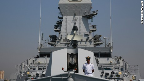 An Indian naval officer stands on board Indian Navys new missile destroyer ship, named Kochi, during a press preview in Mumbai, India, Monday, Sept. 28, 2015. The ship be commissioned on Sept.30, 2015. (AP Photo/Rafiq Maqbool)