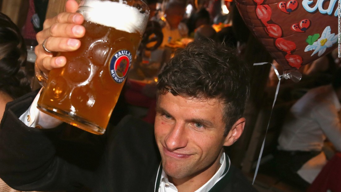 Bayern striker Thomas Muller enjoys a beer at the club's annual visit to Oktoberfest. The Reds recorded a 5-0 win over Dinamo Zagreb in the Champions League on Tuesday.
