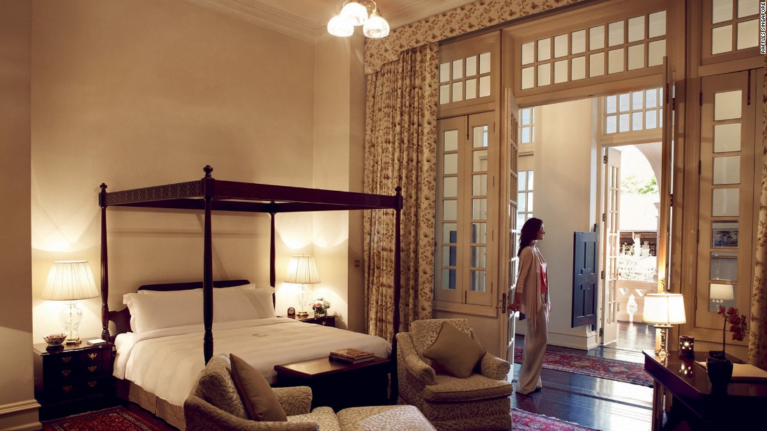 The Raffles' Sarkies Suite bedroom has high ceilings, a four-poster bed and a vast veranda overlooking the gardens.