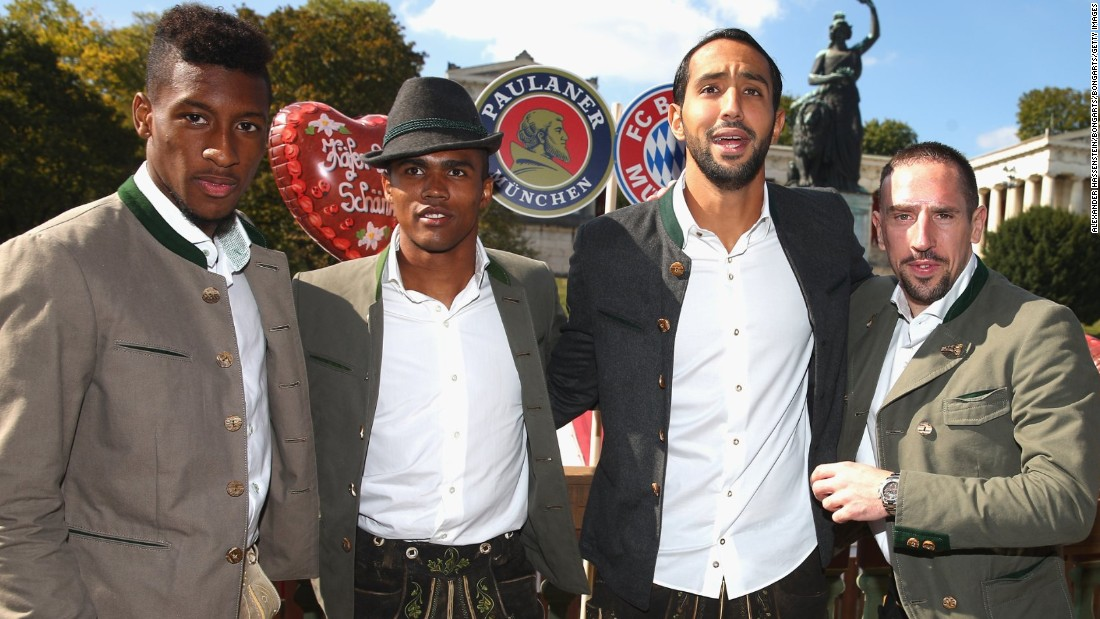 Suit you Sir! Kingsley Coman, Douglas Costa, Medhi Benatia and Franck Ribery scrub up well for the cameras.