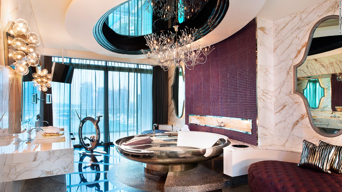 Guests at W Singapore Sentosa's Extreme Wow Suite don't have to choose between those two hotel necessities: a circular bath under a striking chandelier or a designer exercise bike.