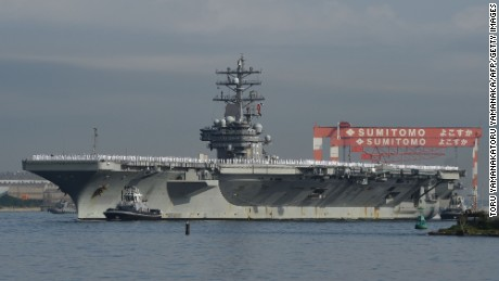 Aircraft carrier USS Ronald Reagan arrives at the US Navy base in Yokosuka, a suburb of Tokyo, on October 1, 2015. The US Navys Nimitz-class aircraft carrier USS Ronald Reagan (CVN 76) departed San Diego for Yokosuka on August 31 to replace the aircraft carrier USS George Washington (CVN 73) in the 7th Fleet area of responsibility. AFP PHOTO / Toru YAMANAKATORU YAMANAKA/AFP/Getty Images
