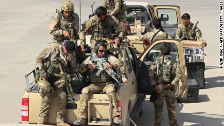 Afghan special forces arrive at the airport as they launch a counteroffensive to retake the city from Taliban insurgents, in Kunduz on Septmber 29, 2015