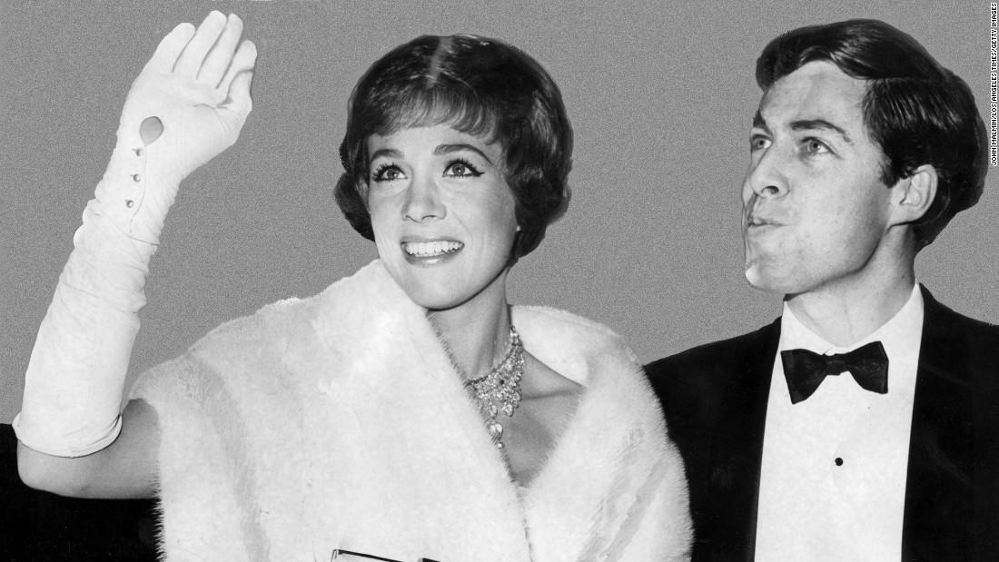 "Andrews arrives at the Oscars with her husband, Tony Walton, in 1965. She would leave the ceremony with the Best Actress award for her role in ""Mary Poppins."""