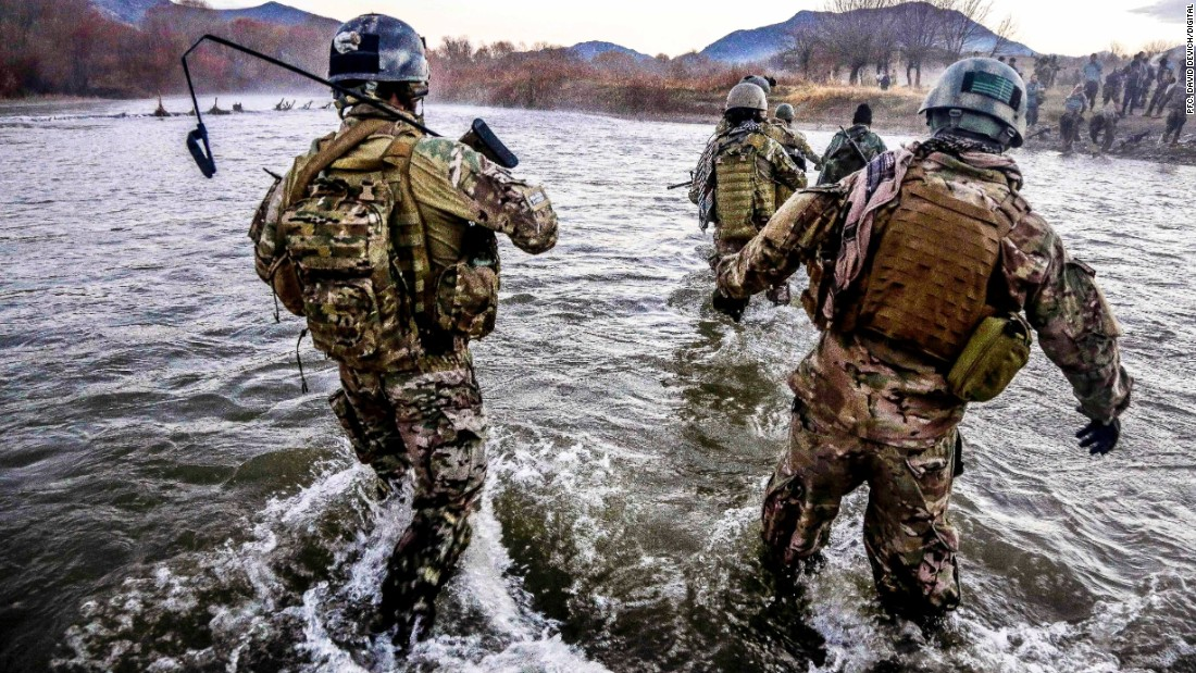 <strong>8. They provide aid in humanitarian crises when other forces are not available</strong><br /><br />In the photo, U.S. Special Forces members cross a wide river during a clearance operation in Zabul province, Afghanistan, in December 2013.