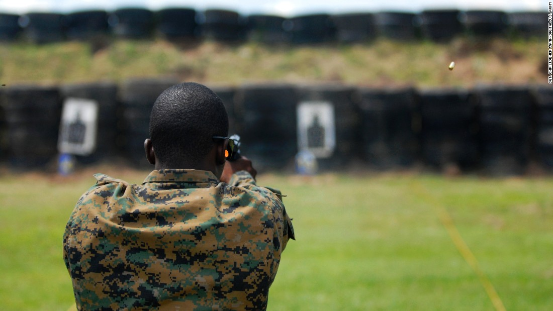 <strong>4. They have their own university -- and are likely to have a college degree</strong><br /><br />In this photo, a member of the Special Operations forces team from the Bahamas practices firing a pistol during weapons familiarization for Fuerzas Comando at the Colombian National Training Center, June 4, 2012.