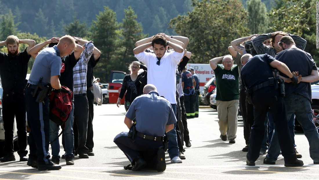 "Police search students outside Umpqua Community College after <a href=""http://www.cnn.com/2015/10/01/us/gallery/oregon-shooting-umpqua-community-college/index.html"" target=""_blank"">a deadly shooting</a> at the school in Roseburg, Oregon, in October. Nine people were killed and at least nine were injured, police said. The gunman, Chris Harper-Mercer, committed suicide after exchanging gunfire with officers, a sheriff said."
