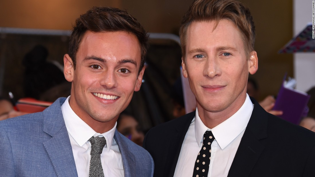 "Olympic diver Tom Daley, left, and screenwriter Dustin Lance Black <a href=""http://www.dailymail.co.uk/tvshowbiz/article-3257363/He-said-yes-said-yes-Tom-Daley-gushes-fiance-Dustin-Lance-Black-shares-heartfelt-photo-diamond-engagement-rings.html"" target=""_blank"">flashed their engagement rings</a> at the Pride of Britain awards in September in London. Daley <a href=""https://instagram.com/p/8U47g0r-tH/?taken-by=tomdaley1994"" target=""_blank"">confirmed their engagement this week via his Instagram account. </a>"