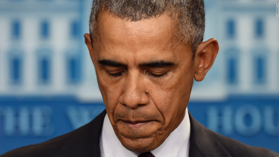 Obama pauses on October 1 during a news conference about the mass shooting at Umpqua Community College in Oregon.