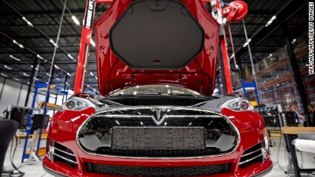 A view of a fully electric Tesla car on an assembly line at the new Tesla Motors car factory in Tilburg, the Netherlands, during the opening and launch of the new factory, on August 22, 2013. The American electric car manufacturer Tesla Motors, led by American-South African inventor and entrepreneur Elon Musk, will be assembling fully electric cars for the European market in this new factory. AFP PHOTO / ANP / GUUS SCHOONEWILLE   ***Netherlands out***        (Photo credit should read Guus Schoonewille/AFP/Getty Images)