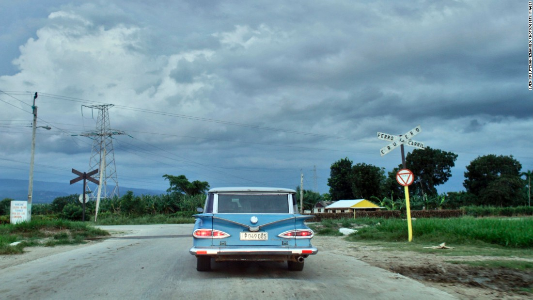 Vintage automobiles are one of Cuba's most iconic sights. This one is crossing a railroad in Biran, the birthplace of Cuban revolutionary Fidel Castro and his brother President Raul Castro.