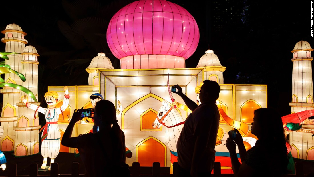 Visitors admire handcrafted lantern decorations during Mid-Autumn Festival celebrations. The event is also sometimes known as Lantern Festival in Singapore and Malaysia.