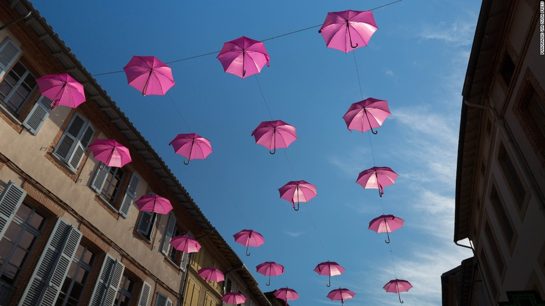 Pink umbrellas decorate a street to mark October's Breast Cancer Awareness Month.