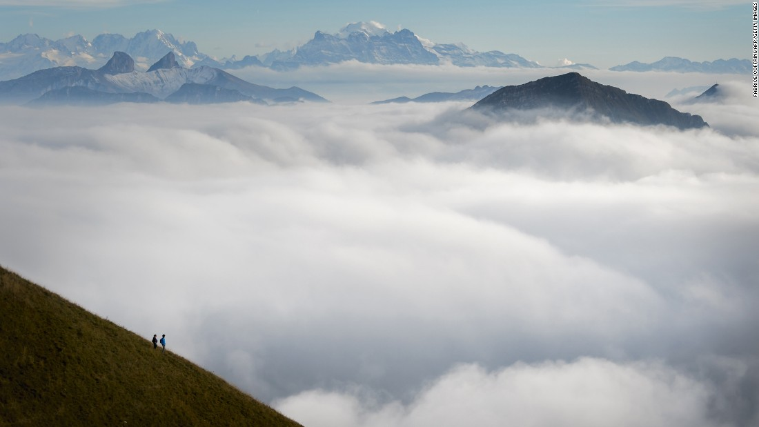 "Tourists stand on top of Moleson Mountain in western Switzerland, looking over a sea of mist. The weather phenomenon is known in German as ""nebelmeer."""