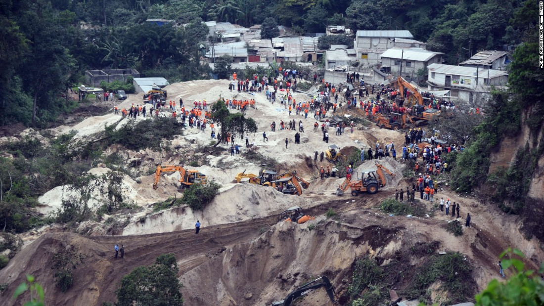 Rescue workers fan out around El Cambray village to search for survivors on October 2.