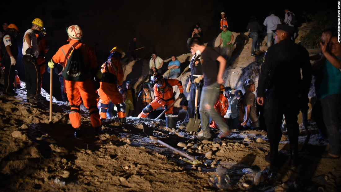 Rescue workers work late into the night on October 2.