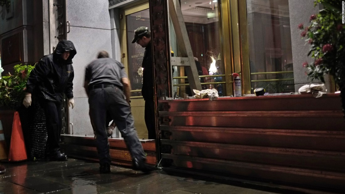 Workers install a flood barrier at the entrance to the Market Pavilion Hotel in downtown Charleston, South Carolina, on Friday, October 2. Parts of the South Carolina coast braced for likely flooding.