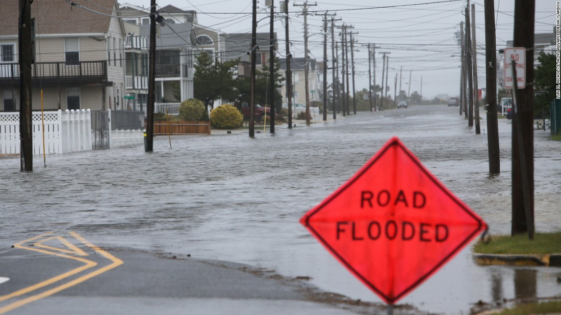 Floodwater rises along Central Avenue in Sea Isle City, New Jersey, on October 2.