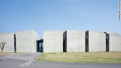 Billionaire Chinese buisnessman Lu Jun asked twenty of the world's leading architects and artists to design buildings for his Sifang Art Park. These six concrete blocks were designed by Chinese dissident artist, Ai Weiwei.