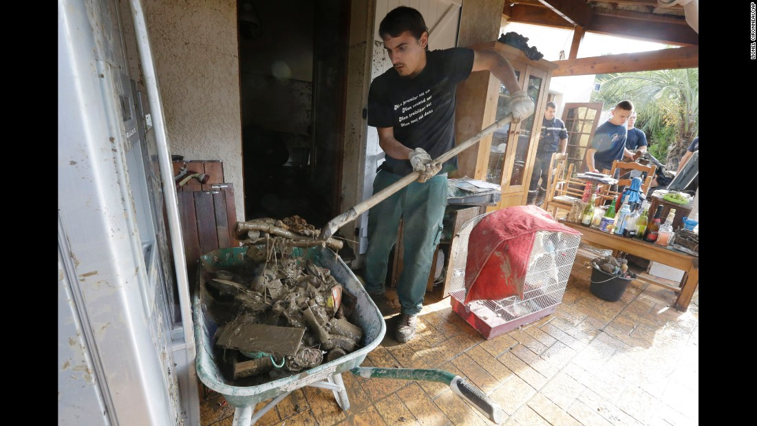 A man cleans a house in Biot, France, on October 5.