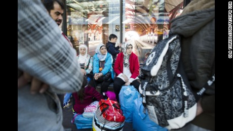 Refugees from Syria sit at the railway station in Malmo, Sweden, on September 7.