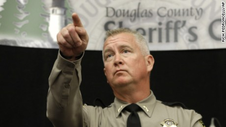 Douglas County Sheriff John Hanlin points to a reporter to take their question concerning the mass shooting at Umpqua Community College, during a news conference Friday, Oct. 2, 2015, in Roseburg, Ore.  Armed with multiple guns, Chris Harper Mercer, walked into a class at the community college, Thursday, and opened fire, killing several and wounding others. (AP Photo/Rich Pedroncelli)