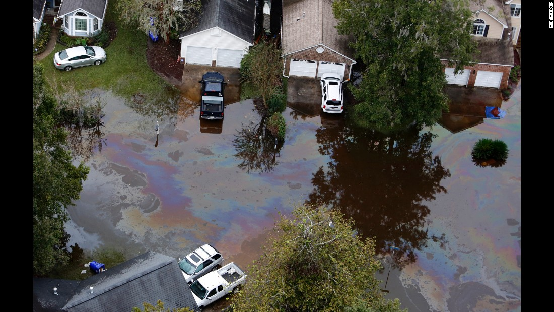 An oil sheen floats atop floodwater in a subdivision west of the Ashley River in Charleston, South Carolina, on October 5.
