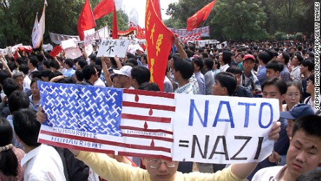 A protestor shouts anti-US slogans as thousands of angry Chinese march to the U.S. embassy in Beijing, May 1999 to protest the NATO bombing of the Chinese embassy in Belgrade.