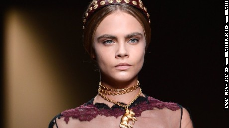 PARIS, FRANCE - OCTOBER 01:  Cara Delevingne walks the runway during Valentino  show as part of the Paris Fashion Week Womenswear  Spring/Summer 2014 at Espace Ephemere Tuileries on October 1, 2013 in Paris, France.  (Photo by Pascal Le Segretain/Getty Images)