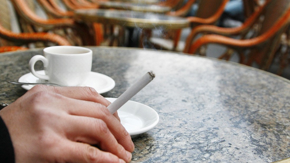 "Parisians can't seem to kick nicotine, even when smokers are banished to freezing cafe terraces. ""New York is the Big Apple, Paris is a big ashtray,"" says Giraud."