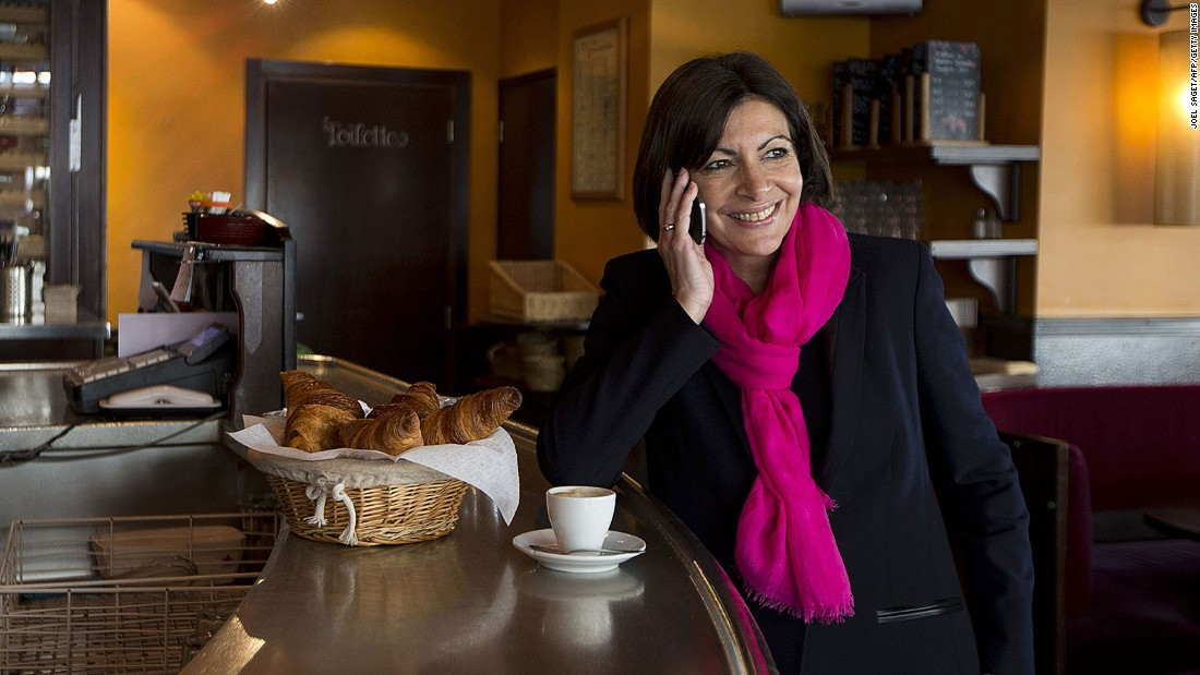 "As demonstrated here by the city's mayor, Anne Hidalgo, Parisians have a penchant for dressing all in black. ""If it's cold, wear a scarf,"" Giraud advises. ""If it's hot wear a scarf also."""