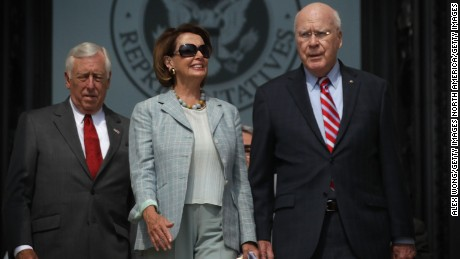 U.S. House Democratic Leader Rep. Nancy Pelosi (D-CA) (C), House Democratic Whip Rep. Steny Hoyer (D-MD) (L) and U.S. Sen. Patrick Leahy (D-VT) (R) come out from the U.S. Capitol for a rally  July 30, 2015 on Capitol Hill in Washington, DC.