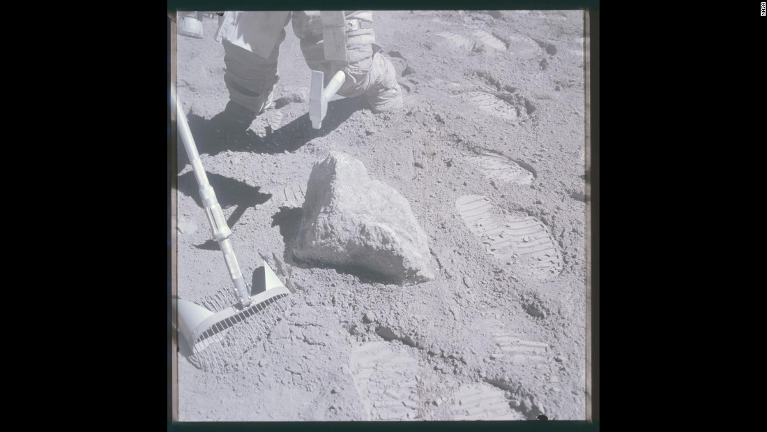 Astronaut Charlie Duke tries to break a sample loose during Apollo 16.
