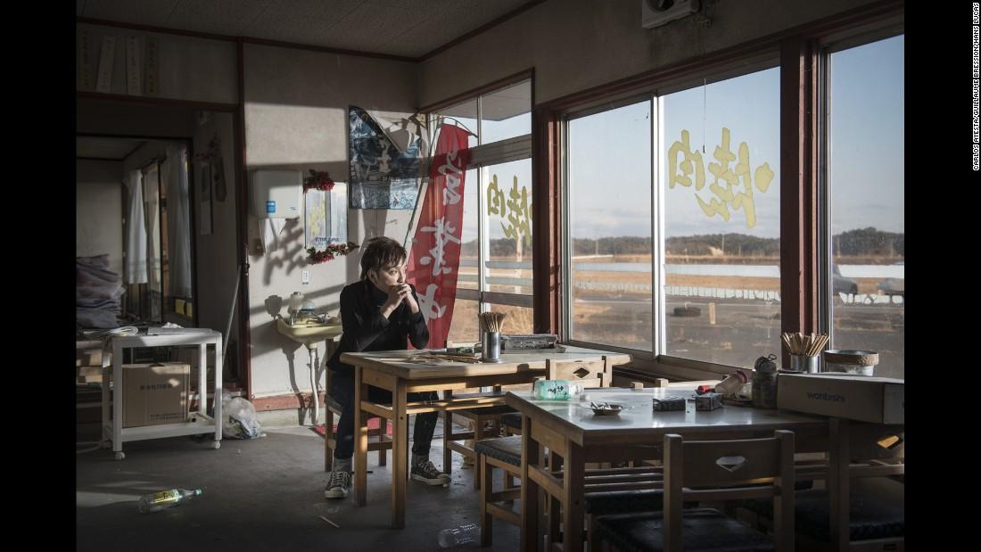 Masayoshi Kawada sits in a ramen restaurant in Namie.