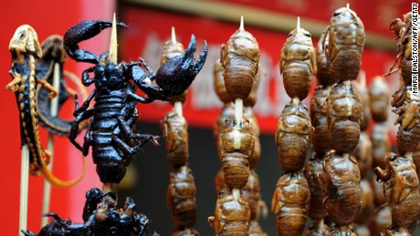 A silk worm larvae to start, then scorpion for the main course.