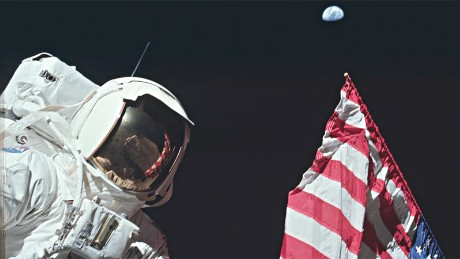 AS17-134-20384 (7-19 Dec. 1972) --- Scientist-astronaut Harrison H. Schmitt, lunar module pilot, is photographed next to the deployed United States flag during lunar surface extravehicular activity (EVA) at the Taurus-Littrow landing site. The highest part of the flag appears to point toward our planet Earth in the distant background. This picture was taken by astronaut Eugene A. Cernan, Apollo 17 commander. While astronauts Cernan and Schmitt descended in the Lunar Module (LM) to explore the moon, astronaut Ronald E. Evans, command module pilot, remained with the Command and Service Modules (CSM) in lunar orbit.