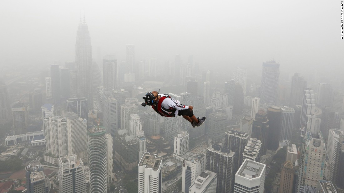 A BASE jumper leaps from the 984-foot high Kuala Lumpur Tower during the International Tower Jump in Malaysia on Friday, October 2. More than 100 people take part.
