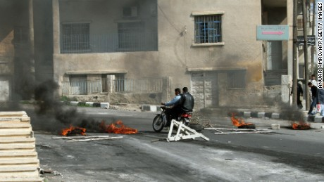 Protesters clash with Syrian security forces on the streets of Daraa in March 2011.