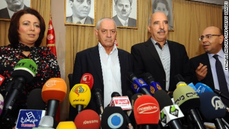 Tunisian mediators arrive to give a press conference to announce the result of its latest bid to mediate an end to the crisis on September 21, 2013 in Tunis. (LtoR) The President of the Tunisian employers union (UTICA), Wided Bouchamaoui, Secretary General of the Tunisian General Labour Union (UGTT) Houcine Abbassi (L) , President of the Tunisian Human Rights League (LTDH), Abdessattar ben Moussa and the president of the National Bar Association, Mohamed Fadhel Mahfoudh. Tunisia's ruling Islamist party, Ennahda announced on September 20, 2013 that it has accepted an ambitious roadmap proposed by the mediators to form a government of technocrats and resolve the country's two-month-old political crisis.