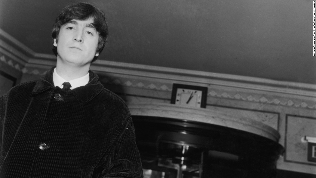 """A Hard Days Night."" With a corduroy overcoat that wouldn't be out of place today, a moody Lennon arrives at the Dorchester Hotel, London, after the publication of his first book, ""In His Own Write."""