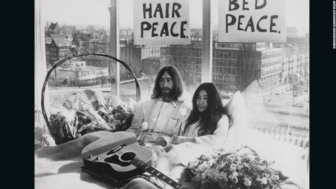 """Golden Slumbers."" Fully embracing the pajama look, Lennon's hair begins to take center stage in 1969."
