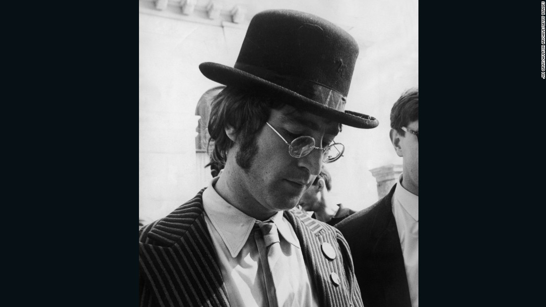 """The Magical Mystery Tour is coming to take you away...""  Back to suits, sort of: Lennon sports a bowler hat and badges during the filming of ""The Magical Mystery Tour"" in 1967."