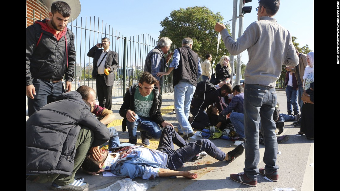 Wounded people receive treatment at the site of the explosion.