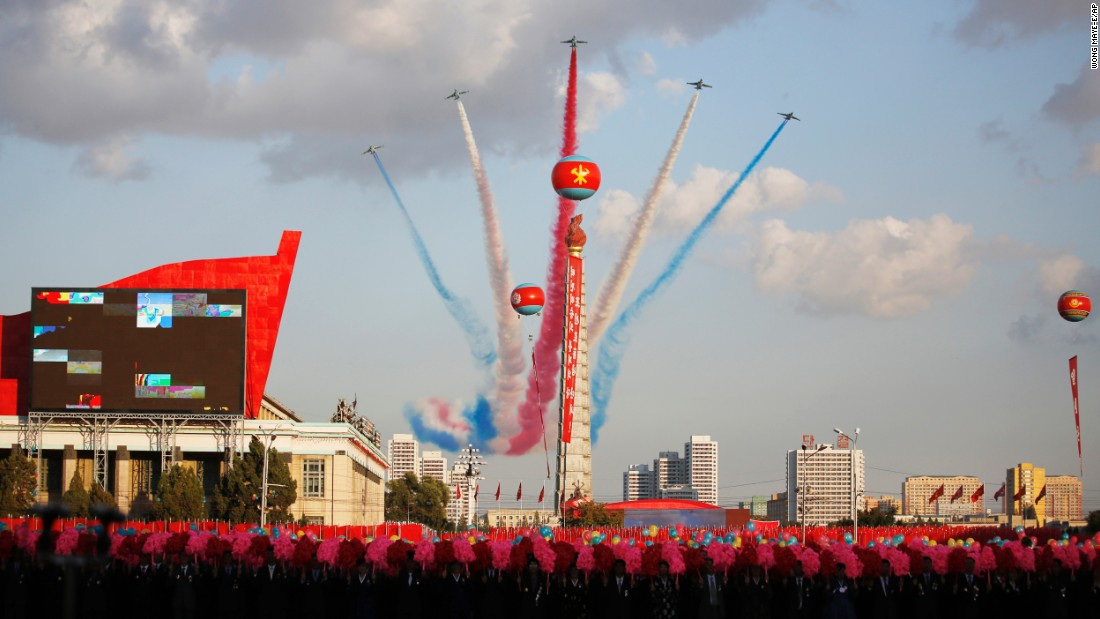 Jets fly over the Juche Tower during the parade on Kim Il Sung Square.