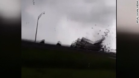 NS Slug: FL: WATERSPROUT DAMAGES US MAIL TRACTOR TRAILER    Synopsis: Waterspout/tornado crosses Sunshine Skyway Bridge in Tampa, rips apart mail truck    Keywords: FLORIDA TAMPA BAY SUNSHINE SKYWAY BRIDGE U.S. POSTAL SERVICE TRUCK
