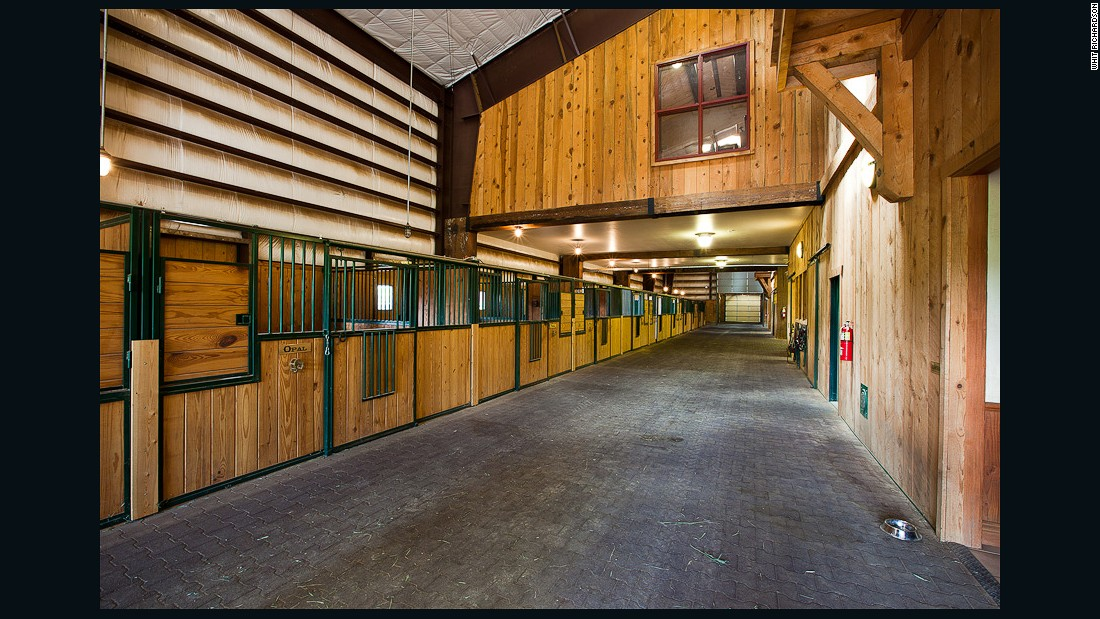 One of the stand-out features of the ranch is a 32,000 sq ft equestrian barn which includes 21 stalls and an on-site veterinary facility.