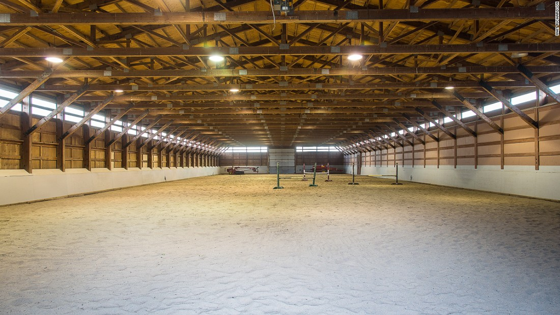 "It is described as a ""premium working ranch"" by Sotheby's International Realty, and includes an Olympic-size riding ring and a 12 stall barn."