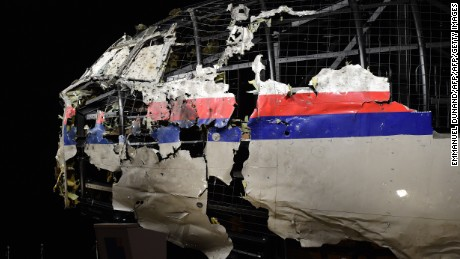 The wrecked cockipt of the Malaysia Airlines flight  MH17 is exhibited during a presentation of the final report on the cause of the its crash at the Gilze Rijen airbase October 13, 2015. Air crash investigators have concluded that Malaysia Airlines flight MH17 was shot down by a missile fired from rebel-held eastern Ukraine, sources close to the inquiry said today, triggering a swift Russian denial. The findings are likely to exacerbate the tensions between Russia and the West, as ties have strained over the Ukraine conflict and Moscow's entry into the Syrian war.   AFP PHOTO / EMMANUEL DUNAND        (Photo credit should read EMMANUEL DUNAND/AFP/Getty Images)