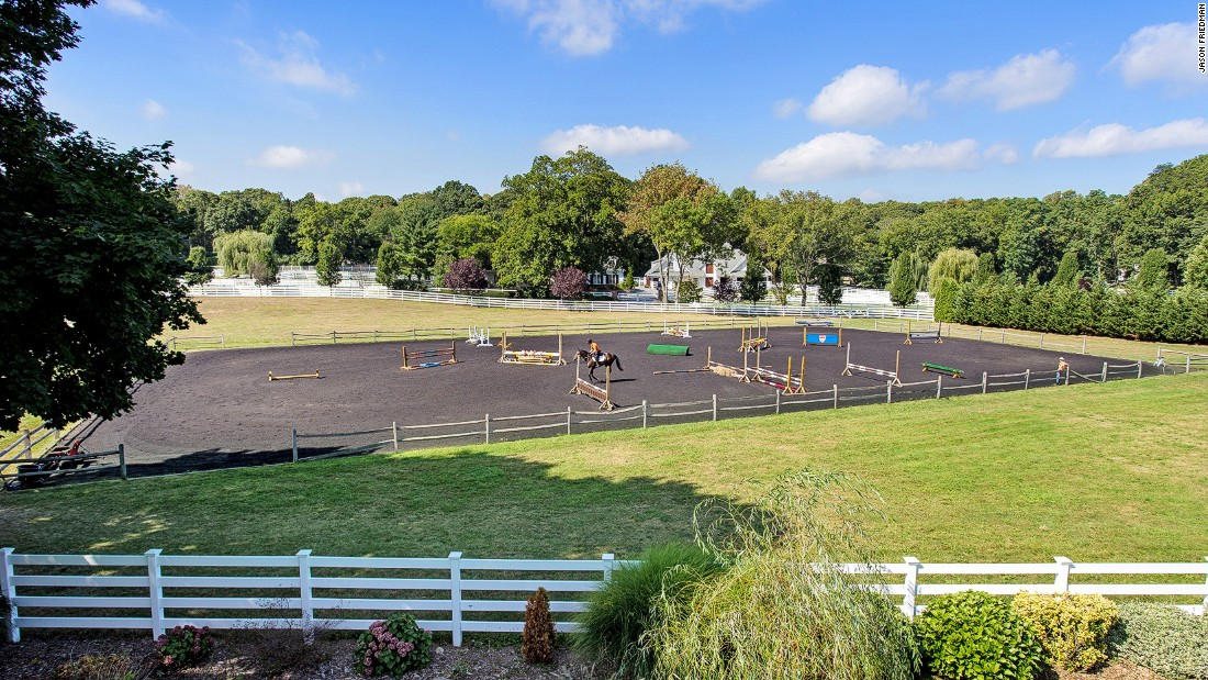 The property comes with an Olympic-sized equestrian arena for the horses ...